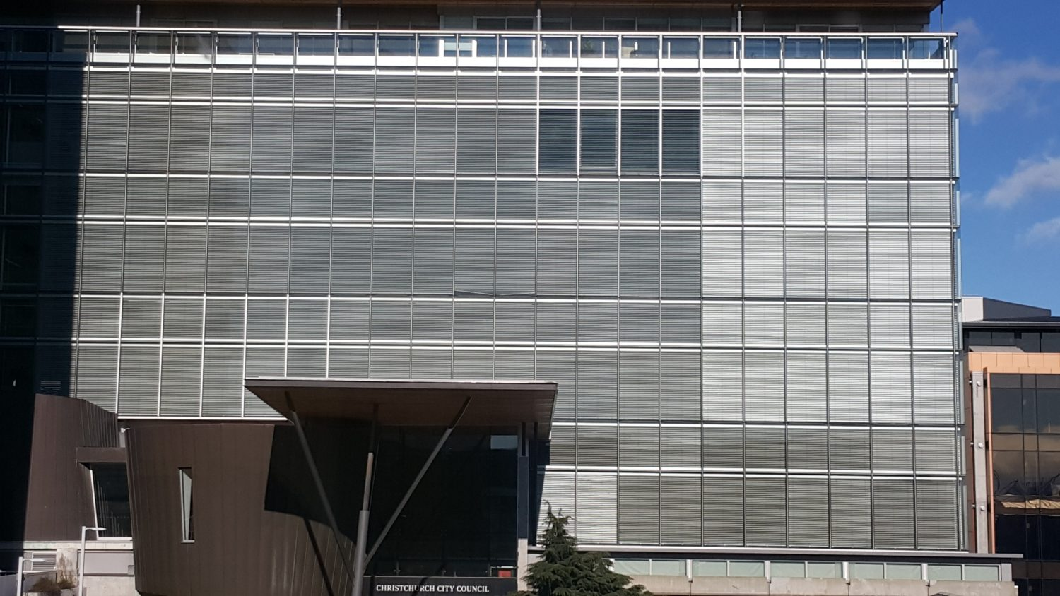 View of Christchurch City Council building, windows covered in blinds